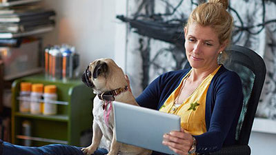 women using ipad with dog